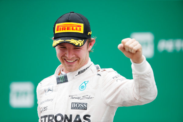 Interlagos, Sao Paulo, Brazil. Sunday 15 November 2015. Nico Rosberg, Mercedes AMG, 1st Position, celebrates on the podium. World Copyright: Charles Coates/LAT Photographic ref: Digital Image _J5R6389