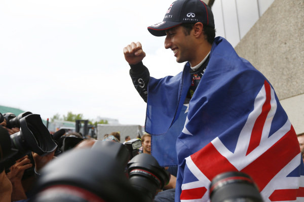 Circuit Gilles Villeneuve, Montreal, Canada. Sunday 8 June 2014. Daniel Ricciardo, Red Bull Racing, 1st Position, celebrates his maiden win with his team. World Copyright: Andy Hone/LAT Photographic. ref: Digital Image _ONZ3793