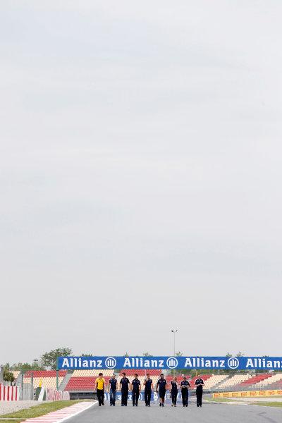 Circuit de Catalunya, Barcelona, Spain 9th May 2013 Pastor Maldonado, Williams F1, and a number of Williams team mates walk the track. World Copyright: Charles Coates/LAT Photographic ref: Digital Image _N7T7525
