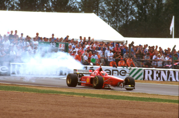 Silverstone, England.12-14 July 1996.Eddie Irvine (Ferrari F310) exits the race as his engine expires in a big way.Ref-96 GB 17.World Copyright - LAT Photographic