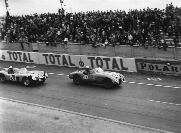 Le Mans, France. 28th - 29th July 1956 Robert Manzon/Jean Guichet (Gordini T15S), retired, leads Alain de Changy/Lucien Bianchi (Ferrari 500 TR), retired, action. World Copyright: LAT Photographic Ref: Autocar Glass Plate C47632.