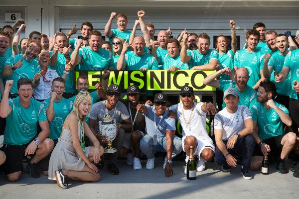 Hungaroring, Budapest, Hungary. Sunday 24 July 2016. Lewis Hamilton and Nico Rosberg celebrate with the Mercedes AMG team after the race. World Copyright: Steve Etherington/LAT Photographic ref: Digital Image SNE10781