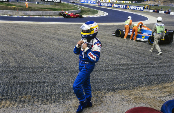 Michele Alboreto walks away from his Minardi M193B Ford after going off into a gravel trap.