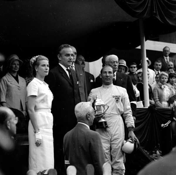 1960 Monaco Grand Prix. Monte Carlo, Monaco. 26-29 May 1960. Stirling Moss (Walker Racing) 1st position on the podium, receives his trophy from HSH Prince Rainier and Princess Grace. Ref-6449. World Copyright - LAT Photographic