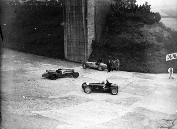 Whitney Straight, Maserati 26M, passes the abandoned Sunbeam Tiger of Malcolm Campbell (#10) and the Bugatti T51 of Tim Rose-Richards (#3).