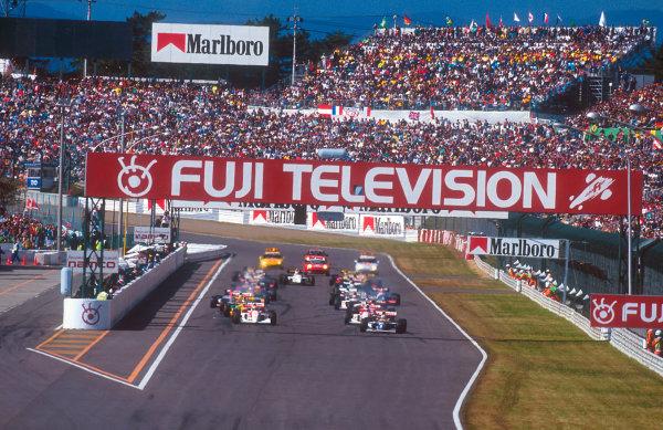 1993 Japanese Grand Prix.Suzuka, Japan.22-24 October 1993.Alain Prost (Williams FW15C Renault) leads Ayrton Senna, Mika Hakkinen (both McLaren MP4/8 Ford's), Michael Schumacher (Benetton B193B Ford), Gerhard Berger (Ferrari F93A) and Damon Hill (Williams FW15C Renault) away from the grid at the start.Ref-93 JAP 14.World Copyright - LAT Photographic