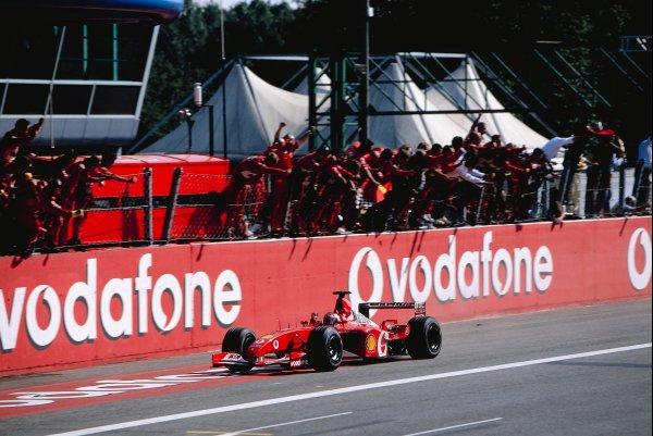 2002 Italian Grand PrixMonza, Italy. 14th - 16th September 2002Rubens Barrichello, Ferrari F2002, crosses the finish line.World Copyright - LAT Photographicref: 35mm Transparency 02_ITA_28