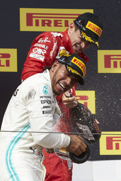 Lewis Hamilton, Mercedes AMG F1, 1st position, and Charles Leclerc, Ferrari, 3rd position, celebrate with Champagne