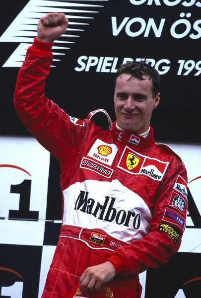 1999 Austrian Grand Prix.A1 Ring, Zeltweg, Austria.23-25 July 1999.Eddie Irvine (Ferrari) celebrates 1st position on the podium.Ref-99 AUT 36.World Copyright - LAT Photographic