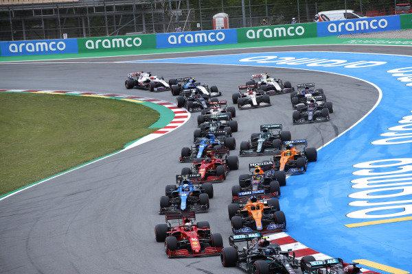 Sir Lewis Hamilton, Mercedes W12, leads Valtteri Bottas, Mercedes W12, Charles Leclerc, Ferrari SF21, Daniel Ricciardo, McLaren MCL35M, Esteban Ocon, Alpine A521, Sergio Perez, Red Bull Racing RB16B, Carlos Sainz, Ferrari SF21, and the remainder of the field on the opening lap