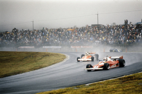 Clay Regazzoni, Ferrari 312T2, leads Jochen Mass, McLaren M23 Ford, as Patrick Depailler, Tyrrell P34 Ford follows.