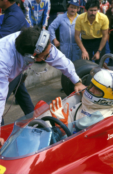 Jody Scheckter talks with an engineer in the pitlane.