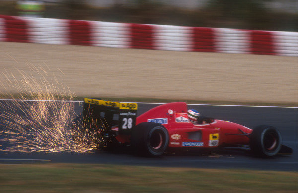 1992 Spanish Grand Prix.Catalunya, Barcelona, Spain.1-3 May 1992.Ivan Capelli (Ferrari F92A) 10th position kicks up the sparks.Ref-92 ESP 05.World Copyright - LAT Photographic