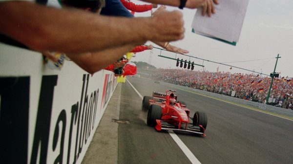 1998 Hungarian Grand Prix.Hungaroring, Budapest, Hungary.14-16 August 1998.Michael Schumacher (Ferrari F300) punches the air as he crosses the finish line after winning the Hungarian Grand Prix.World Copyright - Etherington/LAT Photographic