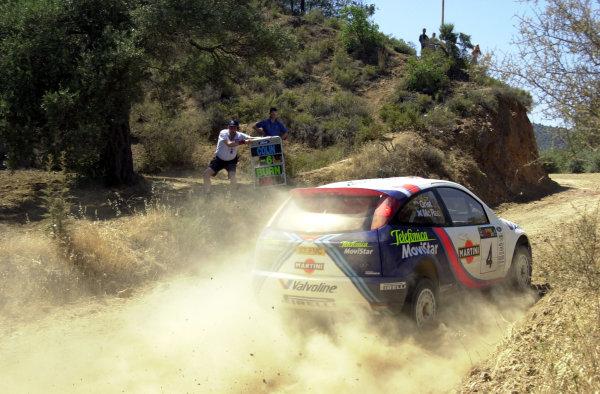 2001 World Rally ChampionshipCyprus Rally June 1-3, 2001Phil Shorts indicates Colin McRae's split time halfway through Stage 19.Photo: Ralph Hardwick/LAT
