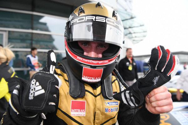 Race winner Martin Ragginger (AUT) Team Porsche Holding celebrates in parc ferme at Porsche Carrera Cup Asia, Rd1, Shanghai, China, 7-9 April 2017.