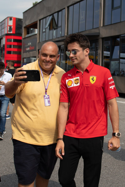 Charles Leclerc, Ferrari takes a selfie with a fan