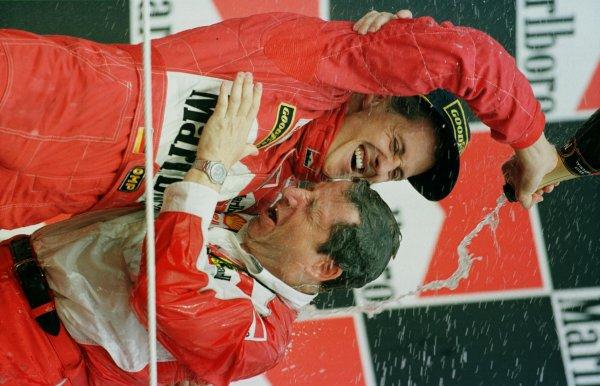 1998 Hungarian Grand Prix. Hungaroring, Budapest, Hungary. 14-16 August 1998. Michael Schumacher and Ferrari Team Principal Jean Todt celebrate victory. World Copyright - Steve Etherington/LAT Photographic