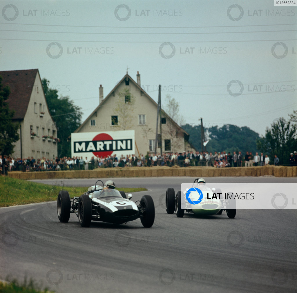 Solitude, Germany. 23rd July 1961.Stirling Moss (Lous 18/21 Climax), retired, chases Jack Brabham (Cooper-Climax T53), 5th position, action.World Copyright: LAT PhotographicRef-3 - 335.