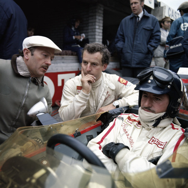 Team boss Colin Chapman and his drivers Jackie Oliver and Graham Hill.