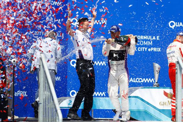2016/2017 FIA Formula E Championship. Round 10 - New York City ePrix, Brooklyn, New York, USA. Sunday 16 July 2017. Sam Bird (GBR), DS Virgin Racing, Spark-Citroen, Virgin DSV-02, celebrates on the podium after winning the race. Photo: Alastair Staley/LAT/Formula E ref: Digital Image _R3I1741