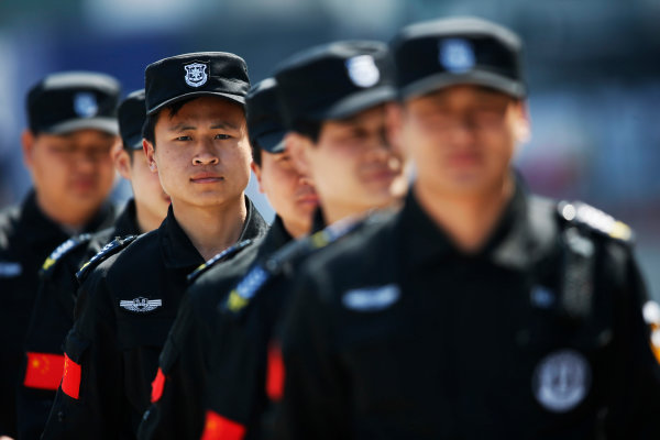 Shanghai International Circuit, Shanghai, China. Saturday 11 April 2015. Chinese security at the circuit. World Copyright: Charles Coates/LAT Photographic. ref: Digital Image _N7T1323