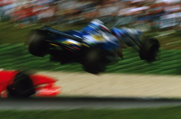 A1-Ring, Austria.19-21 September 1997.Jean Alesi (Benetton B197 Renault) flies in the air after being hit by Eddie Irvine (Ferrari) on lap 37.Ref-97 ITA 01.World  Copyright - LAT Photographic