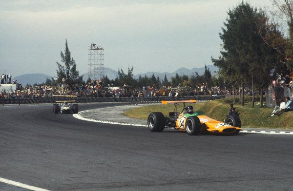 1968 Mexican Grand Prix.  Mexico City, Mexico. 1st-3rd November 1968.  Dan Gurney, McLaren M7A Ford, leads Jack Brabham, Brabham BT26 Repco.  Ref: 68MEX56. World Copyright: LAT Photographic