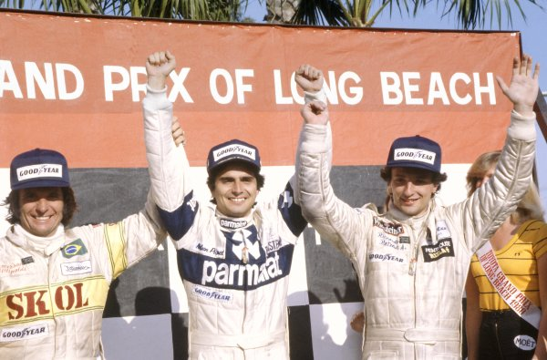 1980 United States Grand Prix West.Long Beach, California, USA. 28-30 March 1980.Nelson Piquet (Brabham BT49-Ford Cosworth), 1st position, Riccardo Patrese (Arrows A3-Ford Cosworth), 2nd position, and Emerson Fittipaldi (Fittipaldi F7-Ford Cosworth), 3rd position on the podium.World Copyright: LAT PhotographicRef: 35mm transparency 80LB10