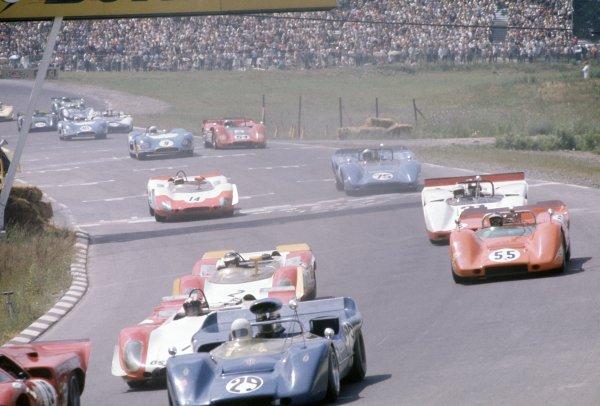 1969 Can-Am Challenge Cup.CanAm race. Watkins Glen, New York State, USA. 13 July 1969.Fred Baker (#29 McLaren M6B-Chevrolet) leads Jo Siffert (#2 Porsche 908 Spyder), John Cordts (#55 McLaren M6B-Chevrolet), Ronnie Bucknum (#31 Lola T163-Chevrolet), Tony Dean (#14 Porsche 908 Spyder), Rob Dini (#75 Lola T162-Chevrolet), Johnny Servoz-Gavin (#9 Matra MS650), Oscar Koveleski (#54 McLaren M6B-Chevrolet) and Pedro Rodriguez (#40 Matra MS650).World Copyright: LAT PhotographicRef: 35mm transparency 69CANAM30
