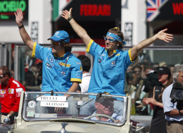 2004 French Grand Prix - Sunday Race, Magny Cours, France. 04th July 2004 Fernando Alonso and Jarno Trulli, Renault R24, waves to the fans on the drivers parade.World Copyright: Steve Etherington/LAT Photographic ref: Digital Image Only