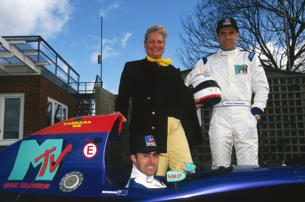 David Brabham (AUS) (in the Simtek S941) with team mate Roland Ratzenberger (AUT) (Right) stand with Barbara Behlau (AUT), a sports manager based in Monaco, who provided finance to enable Roland to sign a contract with Simtek for the first six races of the season.