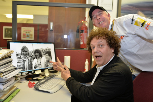 (L to R): Leo Sayer (GBR) singer, and Keith Sutton (GBR) CEO Sutton Images, with a photo of himself, George Harrison (GBR) former Beatle and motorsport enthusiast, and James Hunt (GBR) McLaren, at the 1977 United States GP at Long Beach. Leo Sayer visits Sutton Images, Sutton Images, Towcester, England, 27 June 2013.