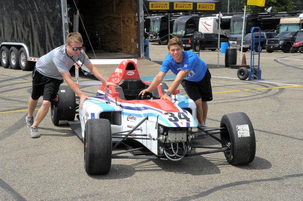 11-14 August, 2016, Lexington, Ohio USA Teammates, Michael Goodyear and Austin Kaszuba pushing car during setup day. ©2016 Dan R. Boyd LAT Photo USA