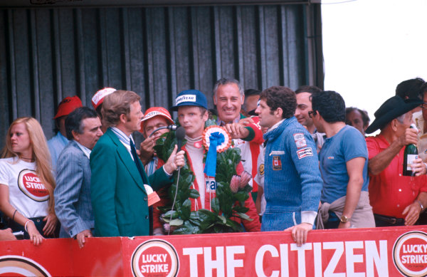 1977 South African Grand Prix.Kyalami, South Africa.3-5 March 1977.Niki Lauda (Ferrari) 1st position and Jody Scheckter (Wolf Ford) 2nd position on the podium.Ref-77 SA 06.World Copyright - LAT Photographic
