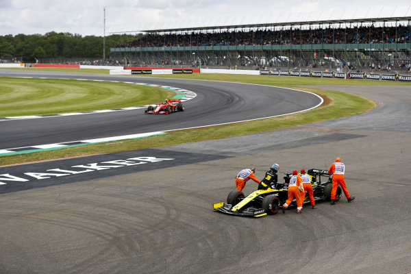 Charles Leclerc, Ferrari SF90 passing the car of Daniel Ricciardo, Renault R.S.19 being pushed by marshals after stopping on track