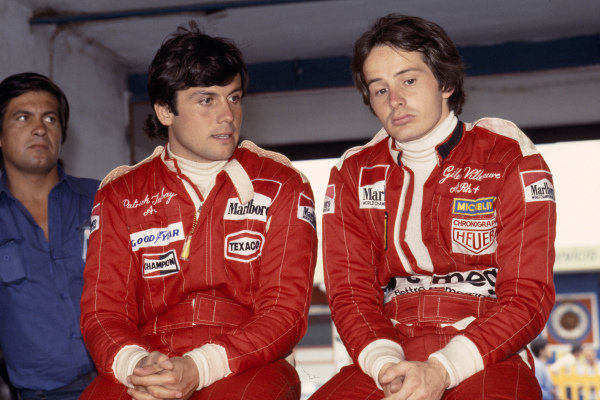 1978 Argentinian Grand Prix.Buenos Aires, Argentina.13-15 January 1978.Patrick Tambay (McLaren) and Gilles Villeneuve (Ferrari) sit together in the garage.Ref-78 ARG 15.World Copyright - LAT Photographic