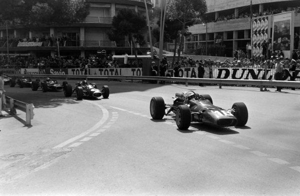 Lorenzo Bandini, Ferrari 312, leads Jack Brabham, Brabham BT19 Repco, and Denny Hulme, Brabham BT20 Repco.