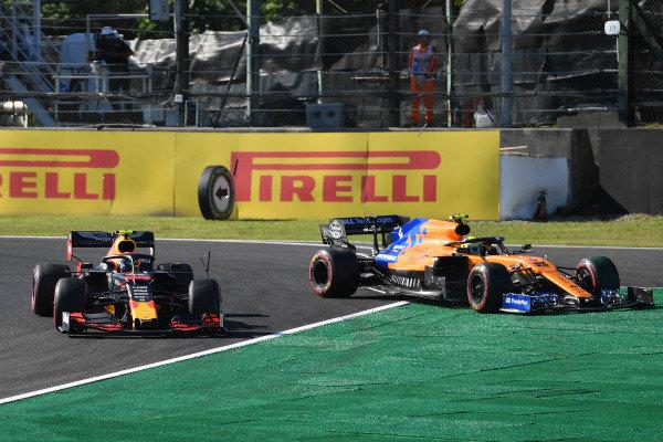 Alexander Albon, Red Bull RB15, passes Lando Norris, McLaren MCL34