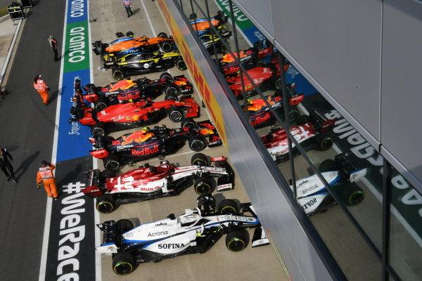 The cars of George Russell, Williams FW43, Kimi Raikkonen, Alfa Romeo Racing C39, Alexander Albon, Red Bull Racing RB16, Charles Leclerc, Ferrari SF1000, Max Verstappen, Red Bull Racing RB16, Daniel Ricciardo, Renault R.S.20, Esteban Ocon, Renault R.S.20, Lando Norris, McLaren MCL35, and Daniil Kvyat, AlphaTauri AT01, in Parc Ferme