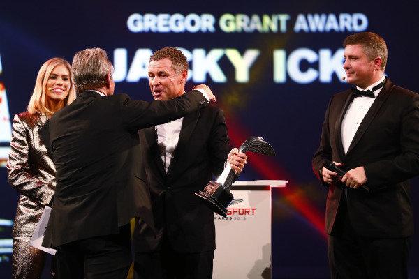 Tom Kristensen presents a Gregor Grant Award to Jacky Ickx