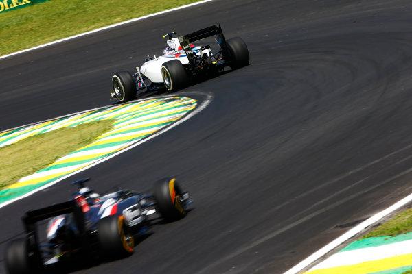 Interlagos, Sao Paulo, Brazil. Sunday 9 November 2014. Valtteri Bottas, Williams FW36 Mercedes, leads Adrian Sutil, Sauber C33 Ferrari. World Copyright: Andrew Hone/LAT Photographic. ref: Digital Image _ONY1673