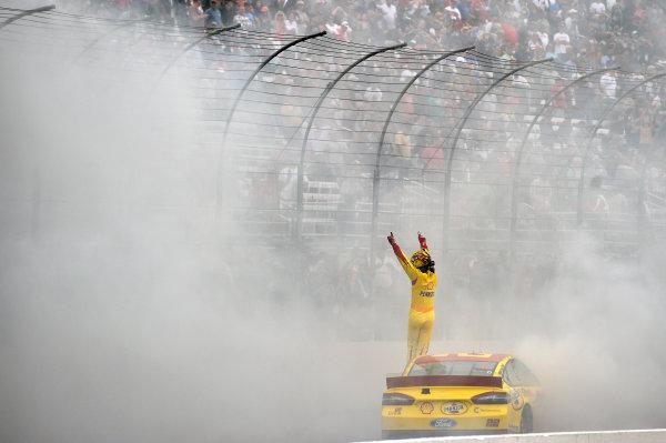 19-21 September, 2014, Loudon, New Hampshire USA Joey Logano celebrates his win with a burnout ?2014, Nigel Kinrade LAT Photo USA