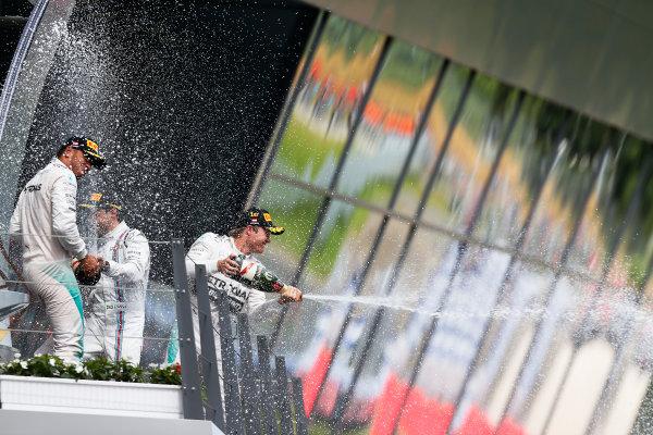 Red Bull Ring, Spielberg, Austria. Sunday 21 June 2015. Nico Rosberg, Mercedes AMG, 1st Position, Lewis Hamilton, Mercedes AMG, 2nd Position, and Felipe Massa, Williams F1, 3rd Position, spray Champagne on the podium. World Copyright: Sam Bloxham/LAT Photographic. ref: Digital Image _SBL7866
