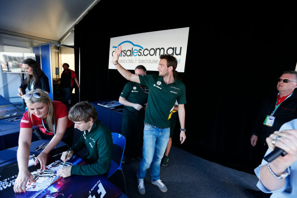 Albert Park, Melbourne, Australia Thursday 14th March 2013 Giedo van der Garde, Caterham F1 and Charles Pic, Caterham F1 sign autographs World Copyright: Charles Coates/  ref: Digital Image _N7T0539