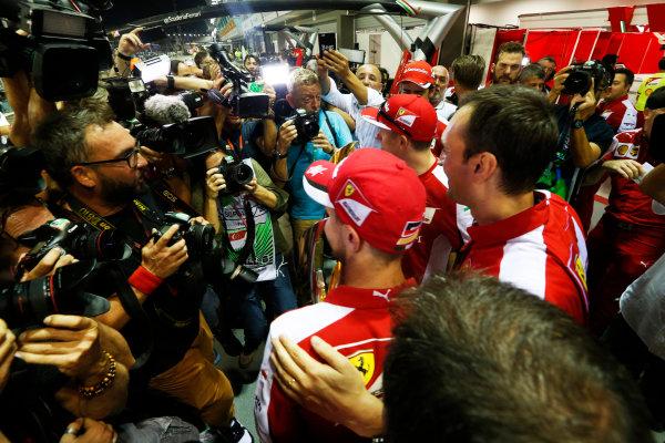 Marina Bay Circuit, Singapore. Sunday 20 September 2015. Sebastian Vettel, Ferrari, 1st Position, Kimi Raikkonen, Ferrari, 3rd Position, and the Ferrari team celebrate a double podium result. World Copyright: Alastair Staley/LAT Photographic ref: Digital Image _R6T7598
