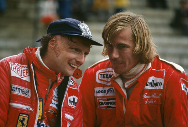 Zolder, Belgium. 3rd - 5th June 1977. Niki Lauda (Ferrari 312T2), 2nd position, shares a joke with James Hunt (McLaren M26-Ford), 7th position, in the pits, portrait.  World Copyright: LAT Photographic.  Ref:  77 BEL 27.
