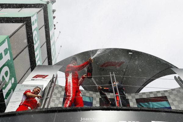 Sebastian Vettel, Ferrari, 1st position, sprays Champagne from the podium.