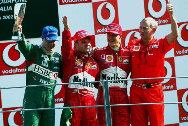 The podium (L to R): Eddie Irvine (GBR) Jaguar third; Rubens Barrichello (BRA) Ferrari winner; Michael Schumacher (GER) Ferrari second; Rory Byrne (RSA) Ferrari Chief Designer.Italian Grand Prix Race, Monza, 15 September 2002.DIGITAL IMAGE