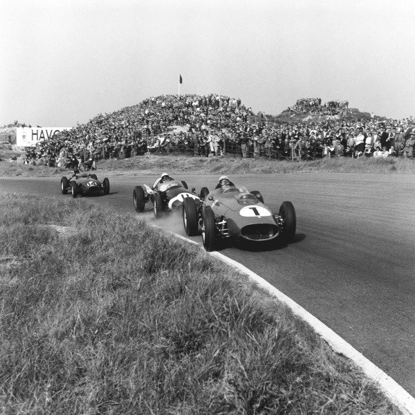 Zandvoort, Holland. 31 May 1959.Jean Behra (Ferrari Dino 246), 5th position leads Stirling Moss (Cooper T51-Climax), retired, and Graham Hill (Lotus 16-Climax), 7th position, action.World Copyright: LAT Photographic.Ref: 4146.